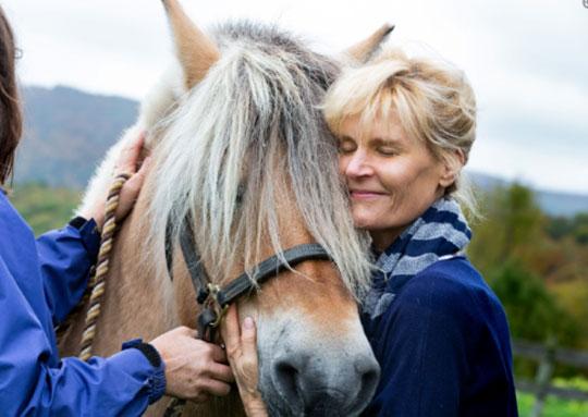 Ann hugging horse