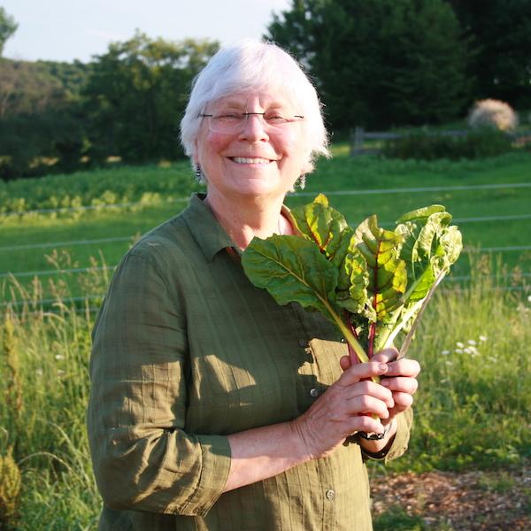Heather holding greens