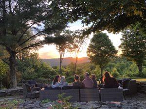 Group enjoying sunset on patio