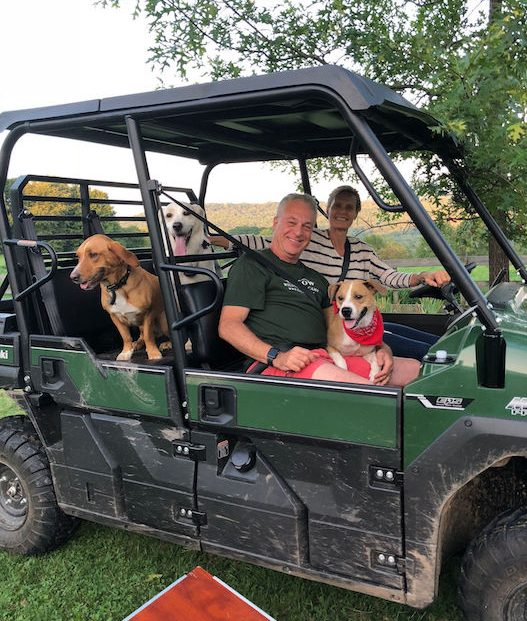 Chris, Ann and dogs in off-roading jeep