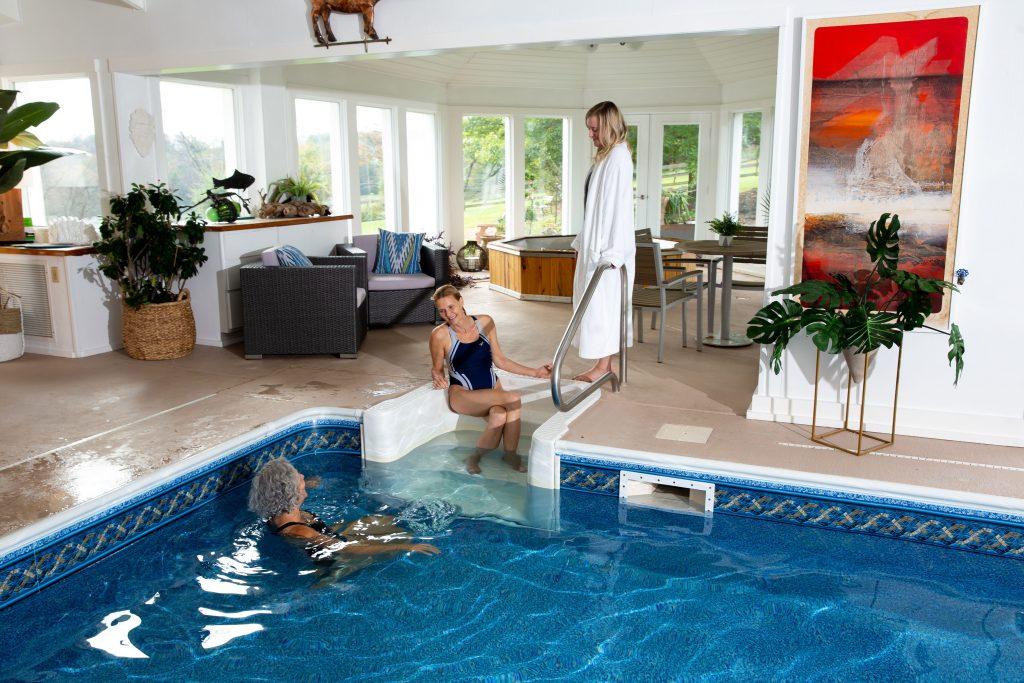 Three women in indoor pool