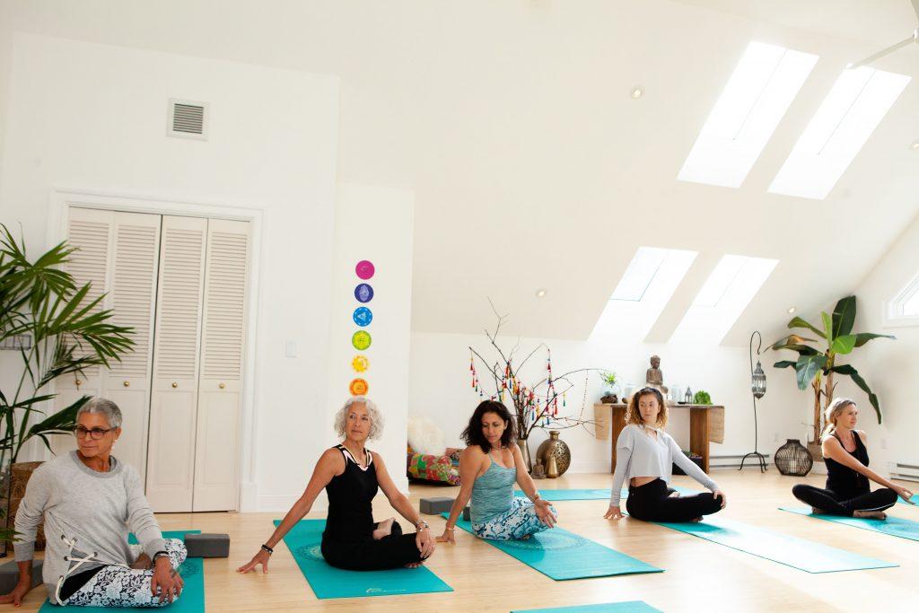 Women doing seated yoga