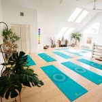 Sunlit yoga room with mats set-up
