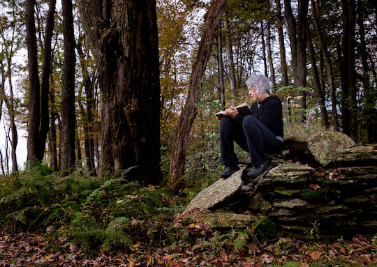 Woman journaling in woods